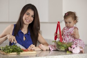 WIC photo mother cooking with baby